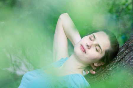 Closeup of a young woman day-dreaming Stock Photo