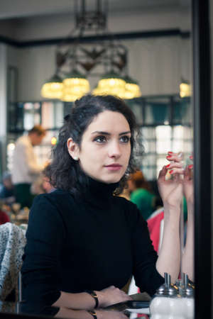Young woman smoking in a stylish old European cafe photo