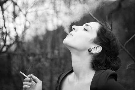 sexy girl smoking: Young woman smoking Stock Photo