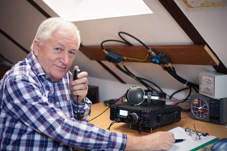 radio active: Enthusiastic middle-aged radio-amateur at his station
