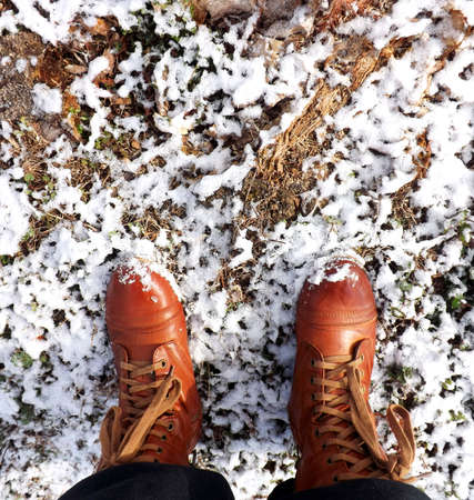 Boots standing on melting snow