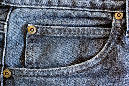 The pocket of a pair of blue jeans photo