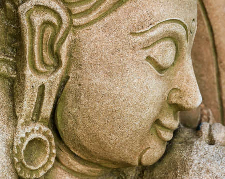 curled lip: closeup of a face of a classical sculpture