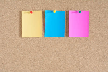 cork board: Colorful notes paper on cork board background