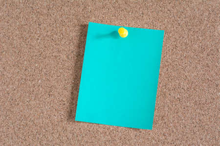 note paper: Green note paper on cork board background
