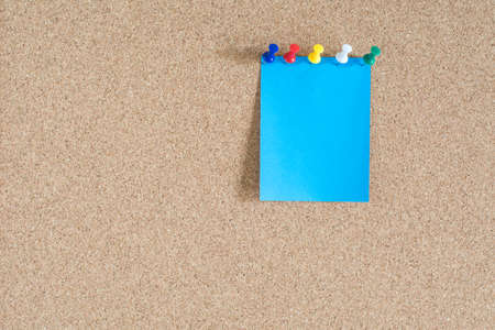 note paper: Blue note paper on cork board background