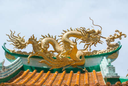 intricacy: Chinese dragon on temple roof. Stock Photo