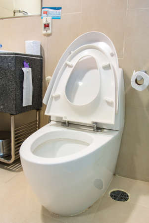 loo: White toilet bowl in restroom