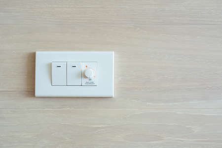 switch: Dimmer switch and light switch on switchboard Stock Photo