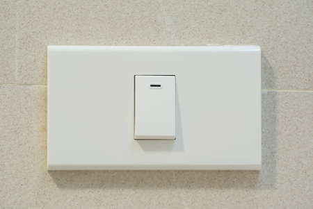 light switch: Light switch on switchboard Stock Photo