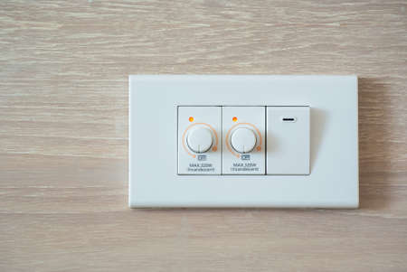 dimmer: Two dimmer switch and one light switch on switchboard