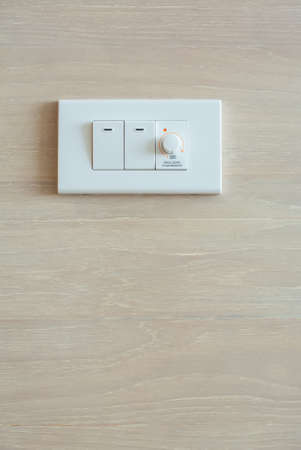 light switch: Dimmer switch and light switch on switchboard Stock Photo