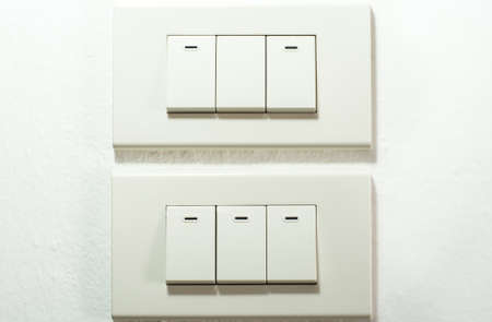 interior walls: Light switch on white wall Stock Photo