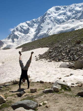 Men train in mountains. Caucasus. photo