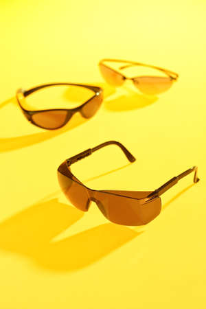 sunglasses in yellow background Stock Photo - 13164486