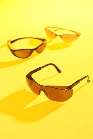 sunglasses in yellow background Stock Photo - 13164486