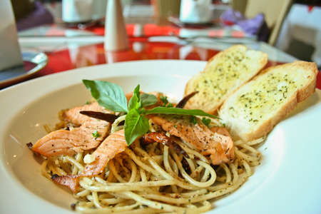 spaghetti salmon and black pepper photo