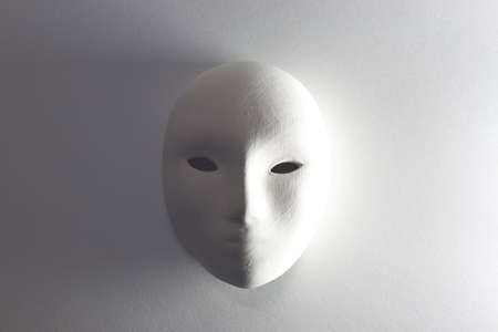 plaster mask in studio, mysterious and horrible style