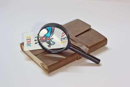 detective notebook   joker  Stock Photo - 13161594