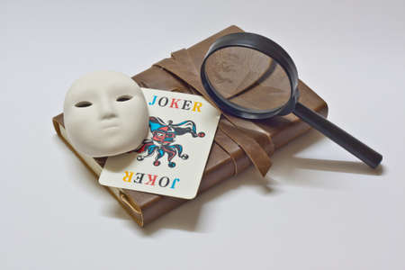 detective notebook   joker  Stock Photo - 13161596
