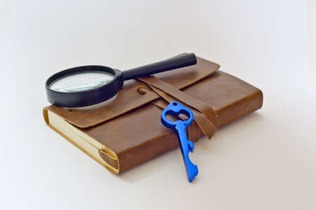 detective notebook   key Stock Photo - 13166846