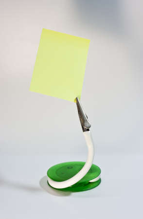 clip stand and post it note, put your message on paper Stock Photo - 13718067