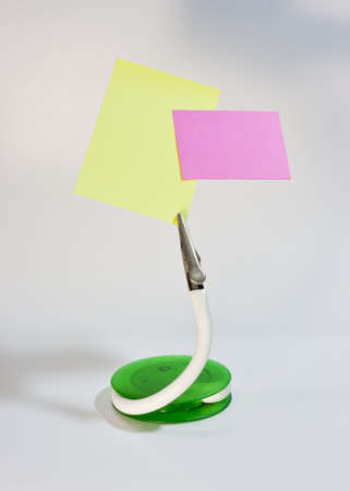 clip stand and post it note, put your message on paper Stock Photo - 13718812