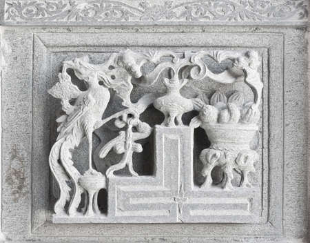 stone carving, the carving is a beautiful taiwan art style.