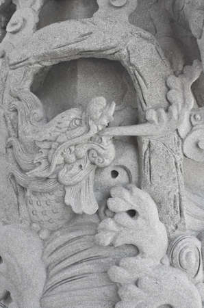 stone carving, the carving is a beautiful dragon. Stock Photo - 14810359