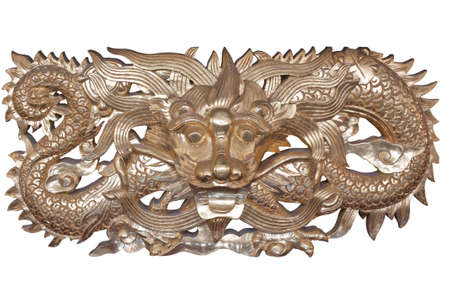 wood carving, the carving is a beautiful dragon.