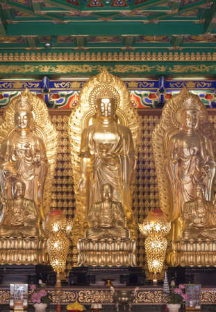 godliness: Buddha statue, Looking at the temple in Thailand  Editorial