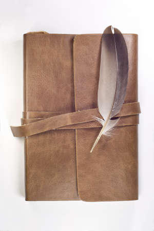 notebook and feather