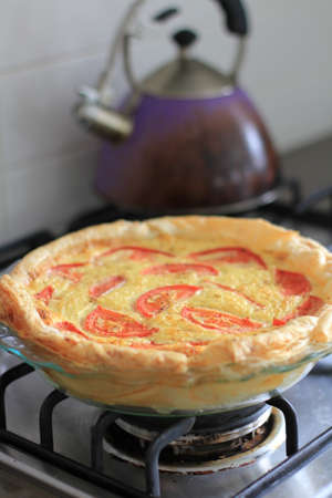 home baked: Home Baked Quiche with Kettle Stock Photo