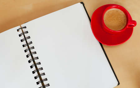 Espresso Coffee and Blank Paper Notebook on Wooden Table photo