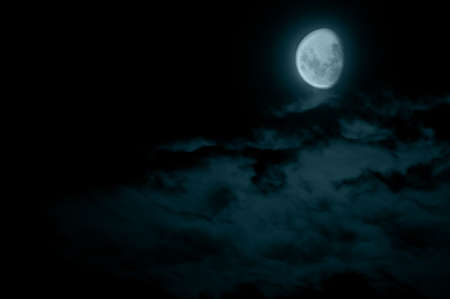 gibbous: Mysterious Waning Gibbous Moon and Dark Clouds Stock Photo