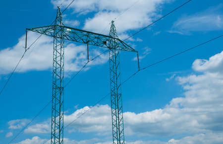 Electric Supply: Pillar With Wires Against Blue Cloudy Sky photo