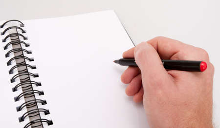 organizer page: Close up of Hand With Red Marker - Open Notebook- Personal Organizer  Stock Photo