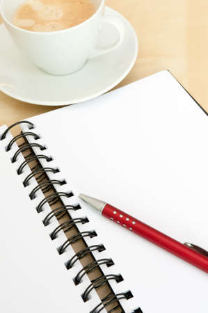 Closeup of Blank Notebook With Ballpoint and Espresso Coffee on Wooden Table Stock Photo - 10497665