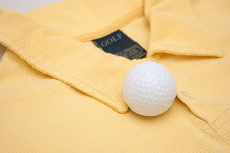 Golf Ball on Yellow Polo Shirt With Golf Sign on Tag Stock Photo - 10653563