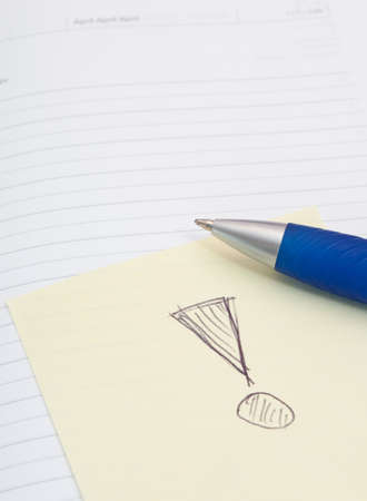 Empty Notebook, Ballpoint and Yellow Memo Stick With Exclamation Mark on White Background photo