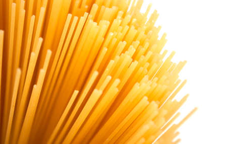 Background - Detail of Raw Spaghetti on White Background photo
