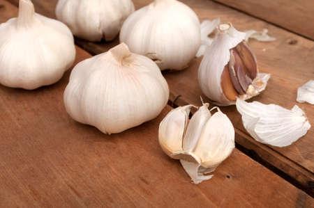 garlic clove: Garlic on Aged Wooden Table