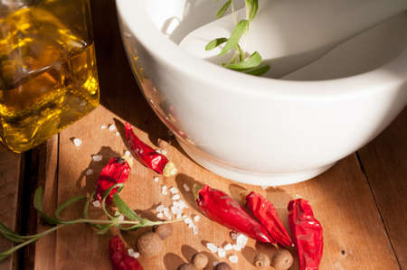 marinate: Cooking - Preparing of Marinade in Mortar - Red Chillies, Rosemary, Salt and Allspice Stock Photo