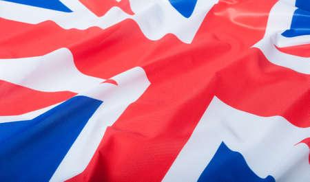 britain flag: Detalle de la Bandera Nacional de seda drapeado Gran bandera de Gran Breta�a Foto de archivo