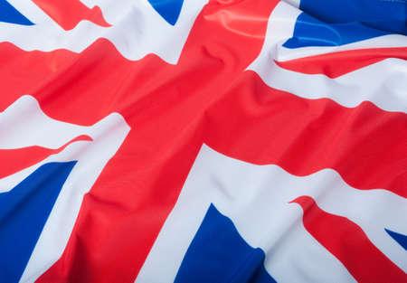 bandera reino unido: Detalle de la Bandera Nacional de seda drapeado Gran bandera de Gran Breta�a Foto de archivo