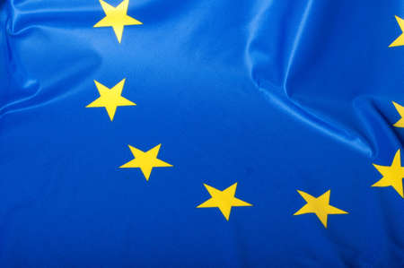Detail of Silky Flag of Blue European Union EU Flag Drapery photo