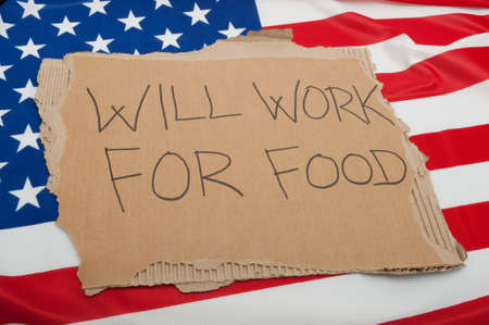 Unemployment in USA - Sign Will Work For Food on Cardboard on American Flag Stock Photo - 10941438