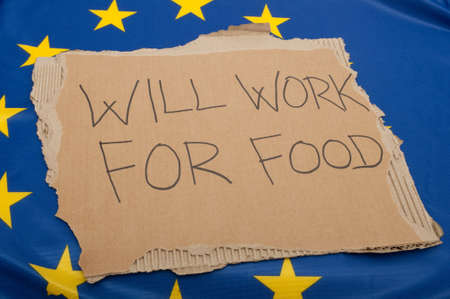 Unemployment in EU - Sign Will Work For Food on Cardboard on European Union Flag Stock Photo - 10941439