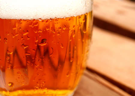Closeup of Glass of Draught Bear in Pub photo