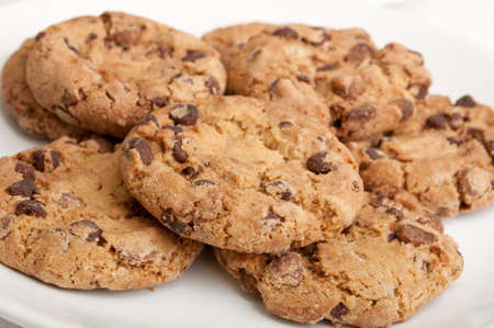 wood chip: Closeup of Chocolate Cookies on White Plate